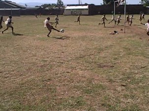 boys playing soccer at the school
